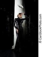 Beautiful young woman in black fashion dress