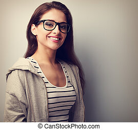 Beautiful young woman in black glasses with toothy smile. Vintage closeup portrait with empty copy space