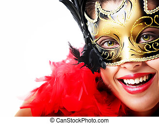 Beautiful young woman in carnival mask and feather boa....
