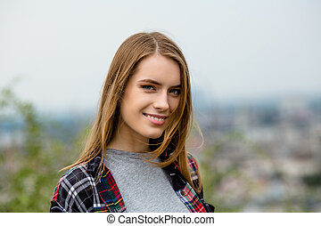 Beautiful young woman in casual clothes.