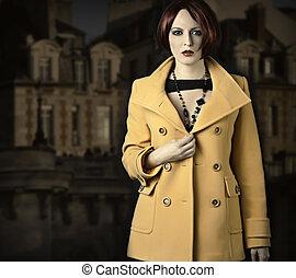 Beautiful young woman in coat