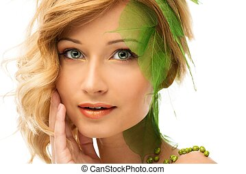 Beautiful young woman in conceptual spring costume touching her face