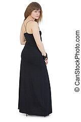 Beautiful young woman in dark long dress