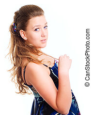 beautiful young woman in dress over white background