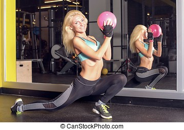 Beautiful Young Woman In Fitness Room