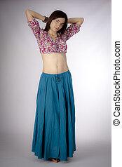 Beautiful young woman in folk dress, studio shot