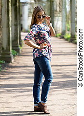beautiful young woman in full length in sunglasses