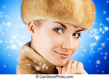 Beautiful young woman in fur cap