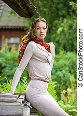 Beautiful young woman in gray dress