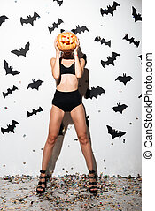 Beautiful young woman in halloween costume cat