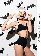 Beautiful young woman in halloween costume cat - Image of...