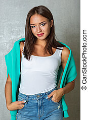 Beautiful young woman in jeans