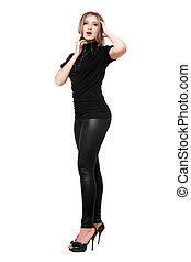 Beautiful young woman in leggings. Isolated