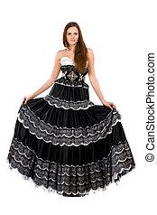 Beautiful young woman in long dress