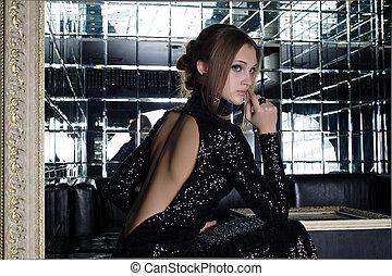 Beautiful young woman in nightclub