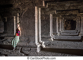Beautiful young woman in old tample in India