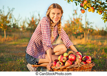 Beautiful young woman  in orchard