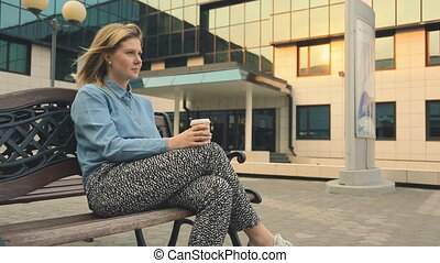 beautiful young woman in outdoor cafe drinking coffee