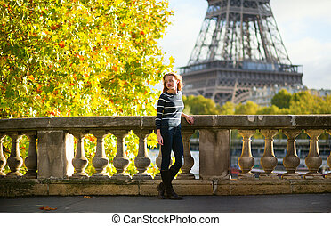 Beautiful young woman in Paris on a fall day