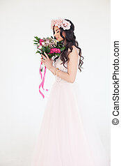 Beautiful Young Woman in Pink Dress. Fashion Model with Flowers and Rose Flower Wreath