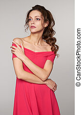 beautiful young woman in pink dress. Isolated
