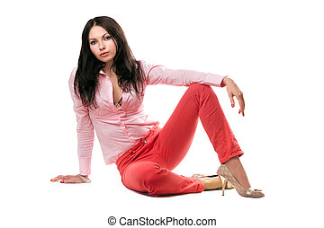Beautiful young woman in red jeans