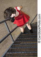 Beautiful Young Woman In Red Vinyl Dress On Fire Escape