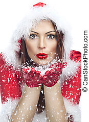 Beautiful young woman in Santa Claus clothes isolated