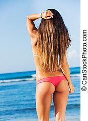 Beautiful young woman in sexy bikini