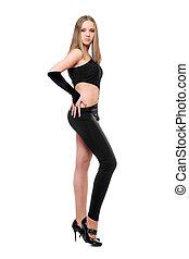Beautiful young woman in skintight black costume