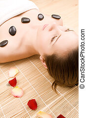 Beautiful young woman in spa center