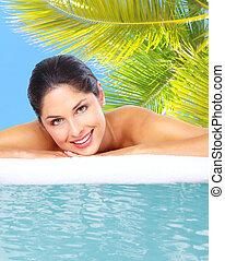 Beautiful young woman in spa massage salon.