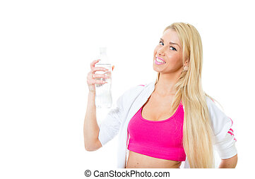 beautiful young woman in sport wear and holding water