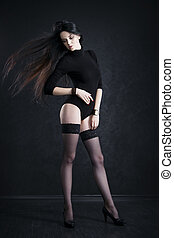 Beautiful young woman in stockings