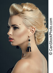 beautiful young woman in Studio on a dark background. Fashion portrait