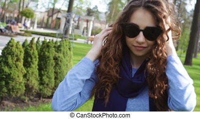 beautiful young woman in sunglasses posing