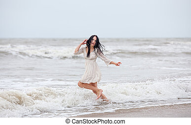 woman in the cold sea waves