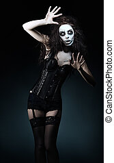 Beautiful young woman in the image of sad gothic freak clown...