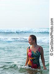 woman in turquoise ocean water