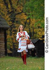 Beautiful young woman in Ukrainian costume