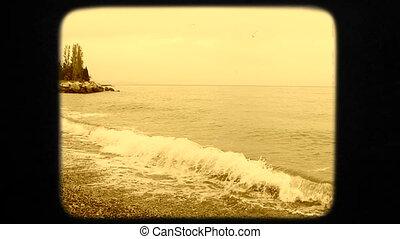 Beautiful Young Woman In White Dress Walking Into Black Sea