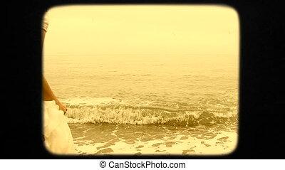 Beautiful Young Woman In White Dress Walking Into Sea