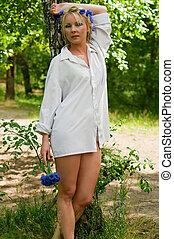Beautiful young woman in white shirt