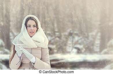 Beautiful young woman in winter forest. Panoramic image.