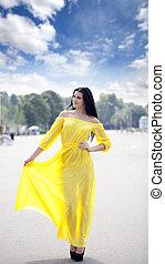 Beautiful young woman in yellow dress