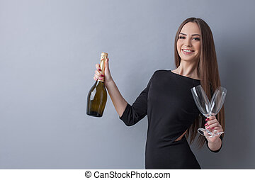 Beautiful young woman is celebrating the event