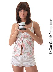 Beautiful young woman is drinking her morning coffee