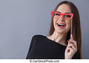 Beautiful young woman is making fun