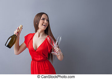 Beautiful young woman is preparing for celebration