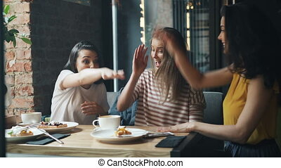 Beautiful young woman joining hands together and laughing in...